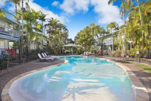 Trpoical setting for lagoon style pools at Coral Beach Noosa Resort