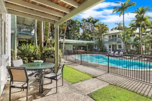 Enjoy a patio overlooking the pool at Coral Beach Noosa Resort