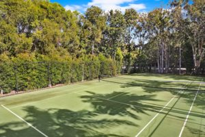 Full size tennis court waiting for you at Coral Beach Noosa Resort