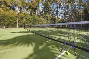 Full size tennis court at Coral Beach Noosa Resort