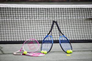 Enjoy a game of tennis at Coral Beach Noosa Resort
