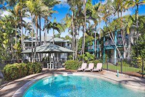Gorgeous pools under blue skies at Coral Beach Noosa Resort