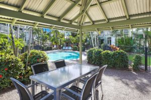 Shaded barbecue areas right by the pools at Coral Beach Noosa Resort